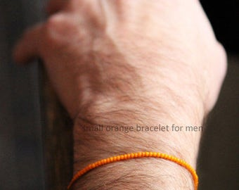 Small orange bracelet for men - vintage bead and gold bead center - a very small bracelet for men