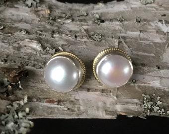 Lustery pearl 14k SS post earrings .