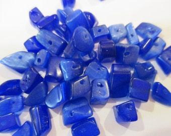 Cobalt Blue Cats Eye Chips, 10 Gram Package, Drilled. Item:BC818611