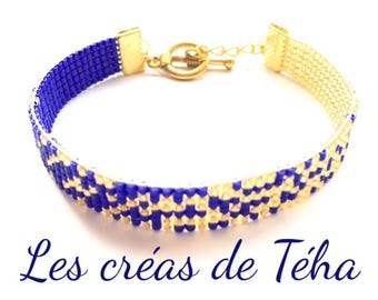 Lovely gold and dark blue bracelet woven with miyuki beads