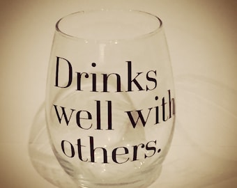 Stemless wine glass drinks well with others