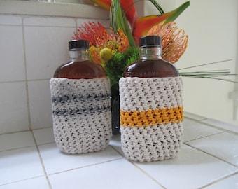 vintage bottles in liquor cozies