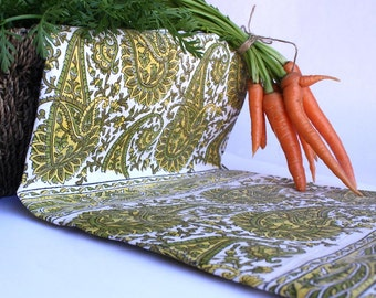 Paisley Indian wood-block printed rectangular tablecloths in shades of green and yellow.