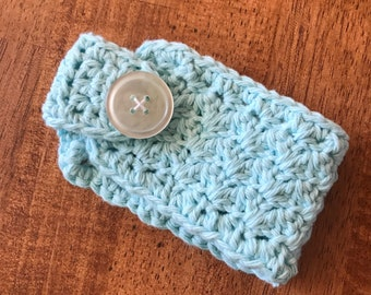Crocheted coffee cup cozy with button