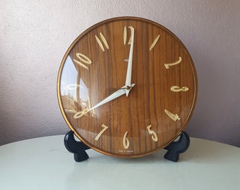 Vintage electric Metamic Wall clock on standard England