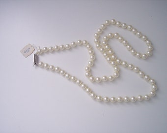 "VINTAGE EATONS  Unused 28"" PEARL necklace"