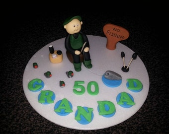 Edible fisherman fishing birthday retirement cake topper