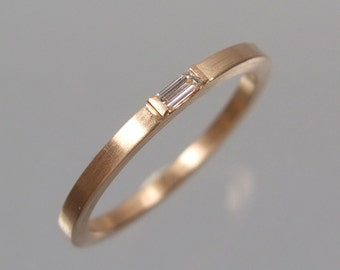 Rosé gold ring 585 with diamond baguette