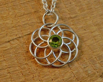Sterling Silver Wire Circles Round Pendant with 7mm round Faceted Peridot Stone