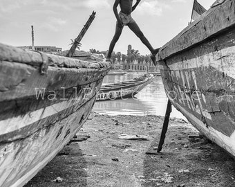 Travel Photography, Boy Walking on the Boats in St.Louis, Senegal Black and White Photography, Fine Art Photography, Vertical Wall Art Print