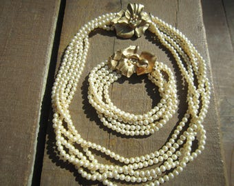 Trifari Faux Pearls and Gold Tone Necklace and Bracelet