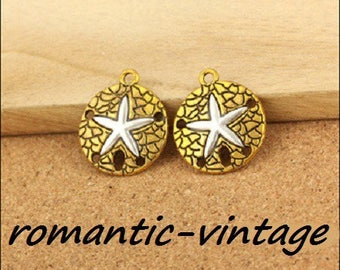 2 charms, connectors round carved, antique gold and Silver Star heart 20mm