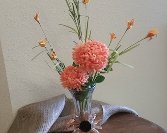 Tall clear vase with burlap band and raffia flower