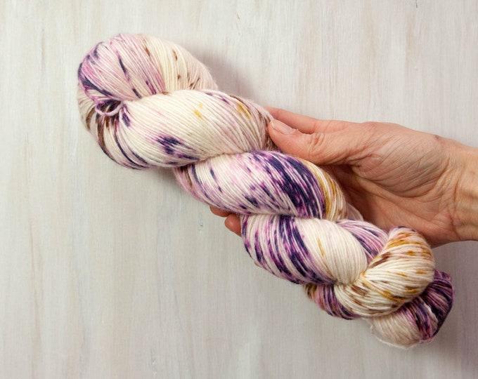 Hand dyed yarn, merino yarn, sock yarn, single ply yarn, dyed sock yarn, speckled yarn, purple yarn, yellow yarn, brown yarn, dyed yarn
