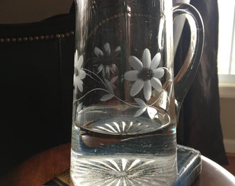 Vintage glass pitcher with etched flowers
