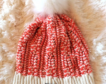 Two-color cable knit beanie with removable pom pom