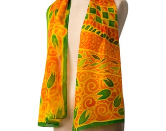 Summer Noon yellow silk scarf hand painted in an orange and green floral design. Fresh French style for the mature lady and a unique gift.