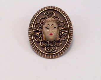 Selro/Selini's Vintage Asian Princess hand painted and mounted on a bronze filigree brooch