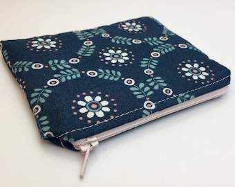 Handmade coin purse/zipper pouch/purse made with floral cotton and fully lined with a water resistant fabric