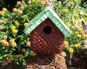 The Little Red Pine Cottage -A birdhouse of scrap materials, this little cottage beauty exudes artistry and elegance for any lawn or garden.