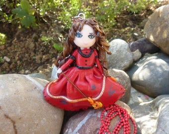 Red doll with polymer clay necklace