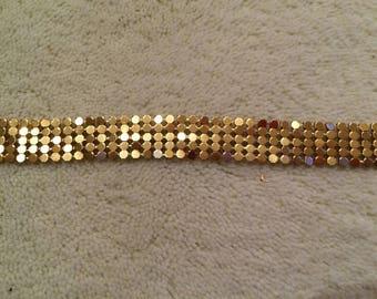 A soft golden metal mesh Ribbon