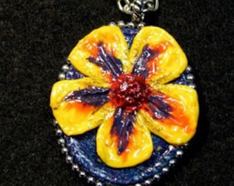Floral design polymer and pewter pendant