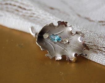 Silver pin with aqua stone and rhinestones