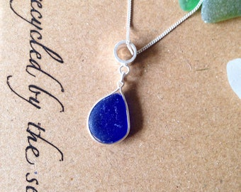 Frosty blue sea glass necklace on a sterling silver chain