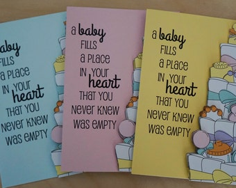 Card A baby fills a place in your heart Layered, Made from repurposed materials and available in three colors