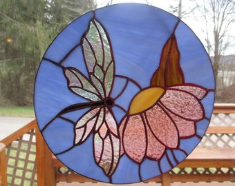 Stained glass butterfly on a mauve flower