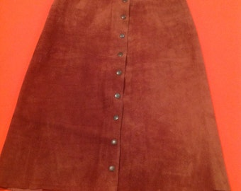 Vintage late 60's, early 70's snap front suede skirt