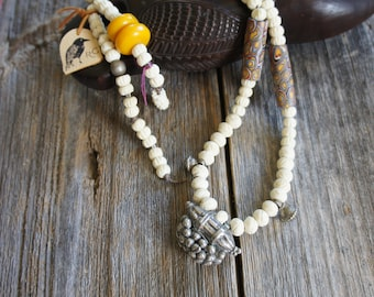 Old asian pendant on carved bone beads necklace
