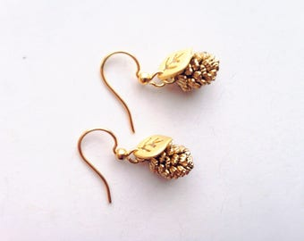 Tiny matte gold leaves and pine cone earrings