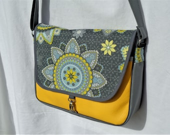 """Leatherette grey and yellow, fabric satchel """"rosettes"""" on the flap."""