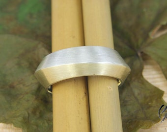 Wide ring of gold 750 / - and silver