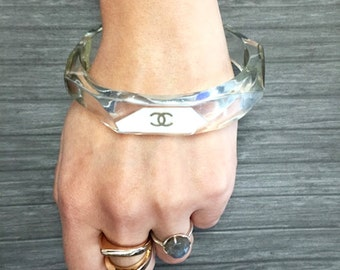 Authentic CHANEL Clear Lucite Bangle Bracelet with CC Logo