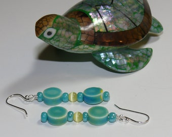 Ladies handmade earrings with ceramic aqua disk beads with a round yellow center glass bead with sterling silver earwires