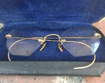 Vintage Bausch and Lomb wrap around 12 karat gold filled bifocal glasses with case