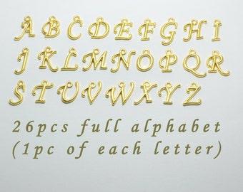 Gold fancy glitter alphabetgold glitter letterscursive font 26pcs a z cursive letter charms in gold alphabet words names initials full alphabet of 26 letters sd s7570 altavistaventures Gallery