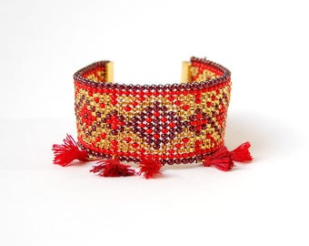 Shaman - Red and gold cuff with PomPoms of ethnic inspiration in beadwork
