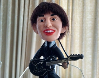It's George! George Harrison from the Beatles tiny doll 1964