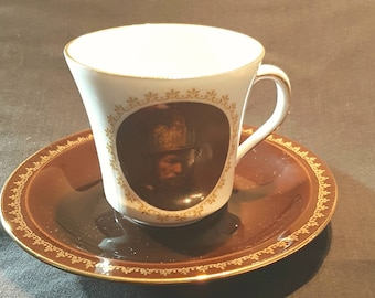 Kronester Bavaria Tea Cup, White Cup with Figure, with Brown/Gold Trim Saucer