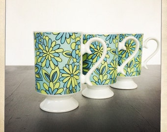 vintage porcelain mugs mod retro flowers blue and green Royal Crown Floral Fashion by Pia