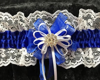 Royal blue  satin and white lace wedding or prom garter. White satin and royal blue chiffon ribbon.  rhinestone center