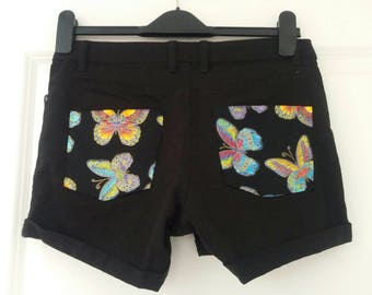 Upcycled black jeans/hotpants with psychedelic butterflies. EU size 36.