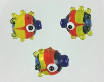 3 Funky yellow, blue and red bumpy glass fish beads
