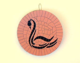 Round mosaic wall hanging with abstract swan pattern