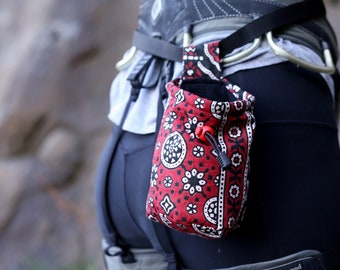 Red and black batik chalk bag; climbing, bouldering, Malawi, Africa