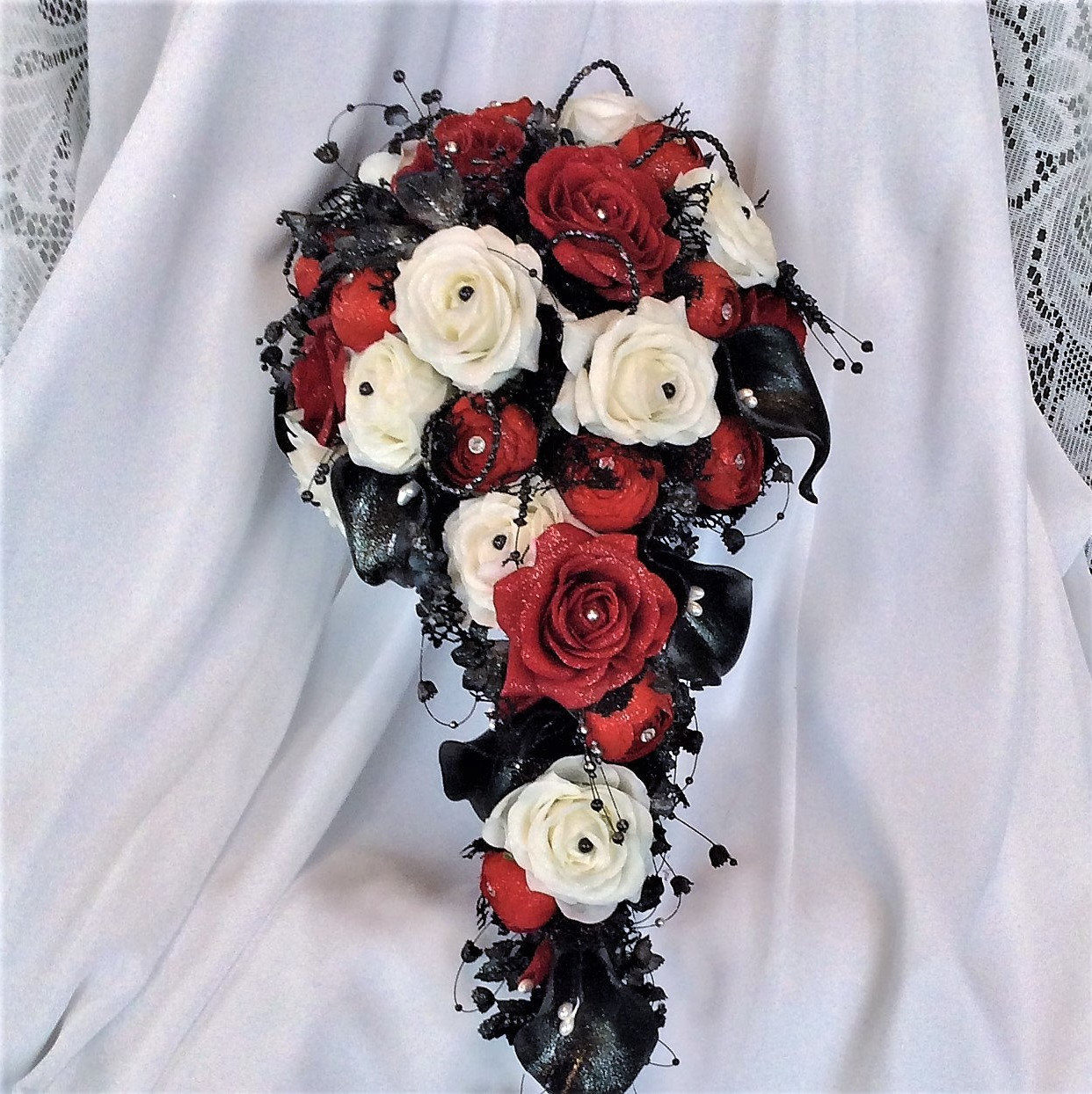 Red white black wedding flower bouquet cascade zoom izmirmasajfo Choice Image